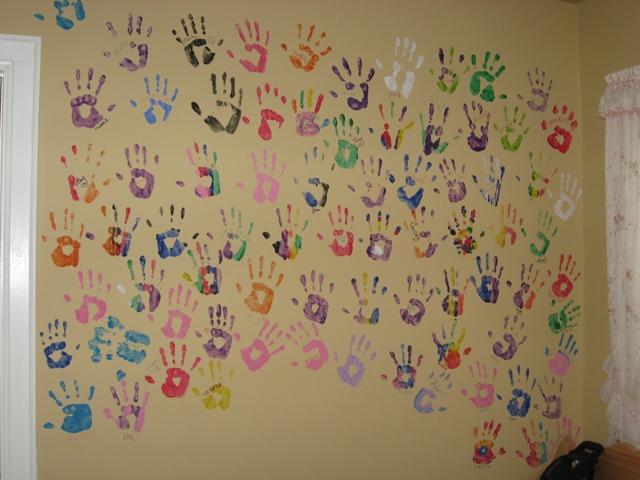 volunteers-hands-on-wall
